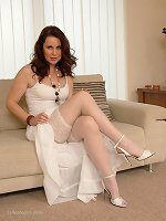 Alison looks simply stunning and virgin like in her matching white dress, stockings and high heels